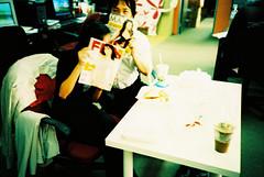 Too Shy (GenkiGenki) Tags: people film computer magazine office lomo lca xpro crossprocessed singapore fuji hide maxim mae fujifilm fhm philip rafflesplace sensia sensia400 32mm cliffordcentre efusion