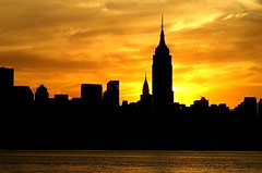 A place in the sun (pmarella) Tags: new city nyc newyorkcity morning sky urban usa newyork color building water beautiful silhouette skyline clouds sunrise wow reflections river landscape newjersey minolta manhattan nj silhouettes whatever viewlarge empirestatebuilding elegance riverviewpkproductions