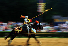 The Joust (` Toshio ') Tags: people horse man motion festival maryland riding slowshutter knight faire pan renaissancefestival joust panning renaissance renaissancefaire renfest jousting crownsville toshio