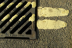 End of the Road (Auntie P) Tags: road street abstract lines yellow pavement ground drain sidewalk lookdown grounded challengeyouwinner challengeyouniner flickr10 msh020910 msh0209