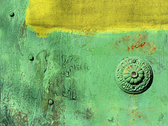 Antique Door (sonofsteppe) Tags: street door old city urban abstract detail green art texture yellow metal town ancient rust gate iron paint hungary exterior antique metallic painted budapest rusty surface dirty dot explore weathered material abstraction aged visual exploration peephole pest obsolete oldfashioned rivet sonofsteppe pusztafia angyalfld haphazartgreen