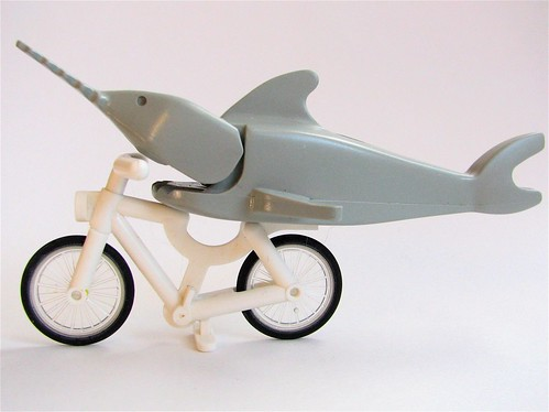 A Lego fish on a Lego bicycle