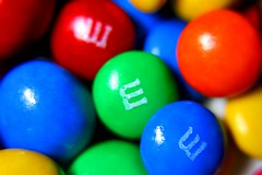The Internet Gets To Everything (Neville_S) Tags: blue red orange colour macro green beautiful yellow amazing fantastic mms colours dof candy bright sweet bokeh internet www m canon350d peanut normal mmmmmm sweetcandy canon305d p1f1 coloerful nevillesukhiaphotography