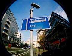 Taxi? (adamski36) Tags: bus sign manchester interestingness lomo lomography taxi fisheye scoopt