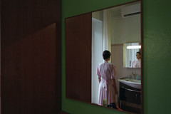 Hotel America (Can Sever) Tags: hotel milan mirror woman 35mm analog green pink dress girl italy