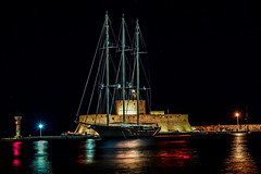 Saint Nikolaos Lighthouse by night (rodiann) Tags: rhodes rhodos greece grecia darkness black colourful lights sea sailboat red blue yellow outdoor harbour architecture