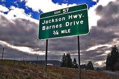 Jackson Highway (Curtis Gregory Perry) Tags: usa signs sign america drive us washington highway state pacific northwest i5 5 united jackson schild pacificnorthwest wa interstate states exit letrero barnes 34 mile bord 57 enseigne   kyltti wegweiser evergreenstate  teken indicacin liikennemerkki uithangbord  criteau