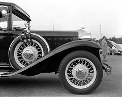 Vintage car profile (Howard Sandler (film photos)) Tags: car vintage classic wheel spare profile blackandwhite largeformat 4x5 hp5 xenar crowngraphic graflex