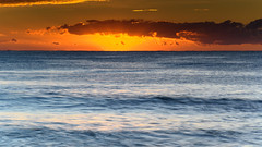 Glowing Sky and Seascape (Merrillie) Tags: daybreak sunrise nature water macmasters centralcoast morning sea newsouthwales rocks earlymorning nsw dawn clouds ocean landscape cloudy waterscape coastal macmastersbeach outdoors seascape australia coast sky waves orange