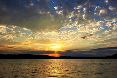 Before the rain sets in (Artist Victoria Watson) Tags: sunset weather river clouds sky water sea colorful sun nature scenic explored