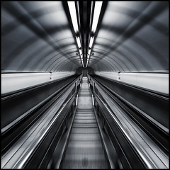 UK - London - Photo24 2018 - Late Night Tube 05_mono flipped sq zoomed v2_DSC2038 (Darrell Godliman) Tags: uklondonphoto242018latenighttube05monoflippedsqzoomedv2dsc2038 londonunderground underground tfl tube metro nighttube latenighttube deserted escalator escalators stair stairs tunnel mono monochrome bw blackandwhite greenpark photo24 photo24london london flipped mirrored symmetry symmetrical zoom zoomburst blurred blur squareformat sq bsquare squares