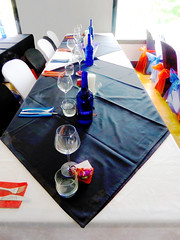Let the Party Starty (Steve Taylor (Photography)) Tags: bottle tablecloth knifeandfork napkin candle silk wineglass tableandchairs window black blue red contrast white cloth newzealand nz southisland canterbury christchurch setting party folds creases