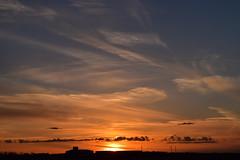 Sunset 5 (darletts56) Tags: sky blue cloud clouds sun sunset silhouette field prairie building poles pole