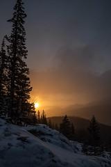 First Light on the Ridge. (mnryno) Tags: spring morning snow colorado forest trees sun orangesky sunrise mountains