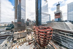 Wide Angle View of Hudson Yards (20180418-DSC04987-Edit) (Michael.Lee.Pics.NYC) Tags: newyork hudsonyards publicsquareandgardens vessel retailspace neimanmarcus aerial reflection curtainwall glass stone manhattanwest construction architecture cityscape javitsconventioncenter sky clouds sony a7rm2 voigtlanderheliar10mmf56
