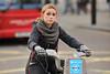 Still Inquisitive (Stuart Mac) Tags: face cyclist bike barclays street candid woman 135mm d700 f2 winter gloves curious inquisitive