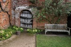 Garden corner (halifaxlight) Tags: england warwickshire packwoodhouse lapworth nationaltrust garden bench door wall border flowers lawn tree path