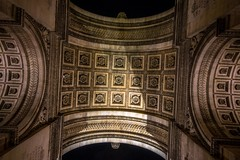 Looking up at the Arc de Triomphe.
