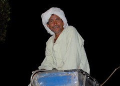 Magical Places and Things -Egypt- The Nile (8) (The Spirit of the World ( On and Off)) Tags: egypt aswan local man portrait buggy seat whip headwrap night horsebuggy middleeast africa northafrica streetsofaswan
