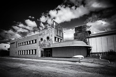 Like a Ship in the Night (Olden Bald) Tags: illinois dairy deco building decay abandoned old urban milk eat butter mississippi river rock island black white