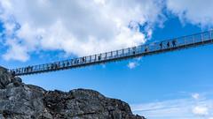 Whistler's Skybridge (Sworldguy) Tags: suspensionbridge whistler peak mountain gondola peaktopeak clouds tourism landscape view sonya73 wideshot skyscape britishcolumbia bc canada