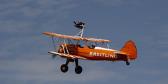 The Flying Circus Wingwalking Team, Shuttleworth Collection Family Air Show, Bedfordshire (IFM Photographic) Tags: img4010a breitlingstearman breitling stearman theflyingcircuswingwalker wingwalker wingwalking nikita aerosuperbatics canon 600d sigma70200mmf28exdgoshsm sigma70200mm sigma 70200mm f28 ex dg os hsm apo tele converter 2x af teleconverter oldwarden bedfordshire beds shuttleworthcollection shuttleworthhouse familyairshow airshow aircraft aeroplane plane airplane boeing
