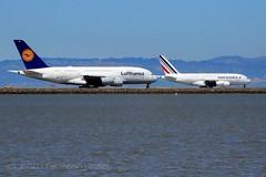 Air France | F-HPJC & Lufthansa | D-AIMC (j.scottsfolio) Tags: daimc lufthansa fhpjc airfrance a380 jumbojet runway taxiing airport sfo airline airplane t5i avgeek sfospotter