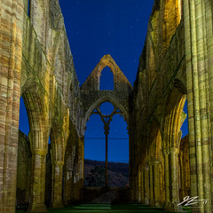 Hear Me and Rejoice #3 (TVZ Photography) Tags: tinternabbey tintern chepstow wales church abbey ruin derelict decay architecture artificiallight stars lights night evening longexposure sonya7r voigtlander 21mm ultron 1x1 square bluehour