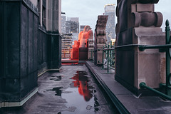 always.already (jonathancastellino) Tags: toronto architecture leica q evening reflection rain statue roof rooftop rooftopping detail edge light red figure derrida gargoyle grotesque ngc
