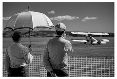 The Umbrella and a Biplane (Mike_Mulcahy) Tags: napier nz canon 5dmkii mono monochrome umbrella plane aeroplane biplane newzealand 500px