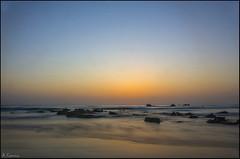 Amanecer (antoniocamero21) Tags: paisaje marina amanecer agua mar cielo rocas color foto sony playa trengandín noja cantabria reflejos horizonte sol atmósfera