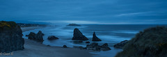 Blue Hour at Bandon (nebulous 1) Tags: bandon oregon pacificocean sunset bluehour island light rays water seastacks nikon nebulous1 glene