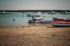 Boats... (hobbit68) Tags: people menschen boats boat beach playa strand sun sonne sunshine water wasser küste work fujifilm xt2 sand arena spanien espagne espanol espana andalucia andalusien sky himmel atlantik