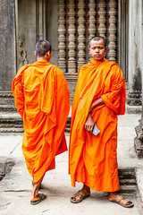 Monks (HellonEarth2006) Tags: cambodia unescoworldheritagesite angkorwat basralief buddhist carvinf man men monk monks orangerobes picture religion religious ruins standing stone stood temple