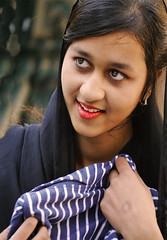 Choosing a jacket (chrisk8800) Tags: young woman girl choosing jacket barcelona