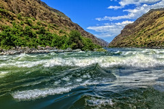 Leaving The Rapids (http://fineartamerica.com/profiles/robert-bales.ht) Tags: aupload fahellscanyon facebook forupload haybales hellscanyontrip idaho people photo photouploads places projects states nature canyon floating recreation river wilderness area remote mountain america usa wild white hell oregon green range vacation scene outdoors scenic hells hiking tourism water salmon blue snake desert eastern fishing fly outdoor riggins rock rugged nez trout beauty steelhead conservation clouds devils tourist gorge mountains washington snakeriver hellscanyon robertbales boat jetboat rapids mixedmedia rafts