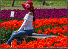 Girl and Flowers (R. Sawdon Photography) Tags: tulipss red orange flowers girl white sweater model posing sunny tulipfarm chilliwack britishcolumbia fraservalley jeans spring candid