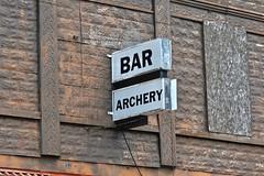 A Bad Combination, Ewen, MI (Robby Virus) Tags: michigan mi up upper peninsula ewen bar archery sign signage bad trouble danger dangerous william tell