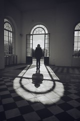 Superposition (Phil W Shirley) Tags: week82018 52weeksin2018 weekstartingmondayfebruary192018 light dark black white tiles windows doorway portal ruckenfigur child figure standing backwards