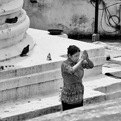 Woman performing prostrations for merit at Boudhanath Stupa, Kathmandu, Nepal (BryonLippincott) Tags: nepal boudhanathstupa asia centralasia religion temple kathmandu tibetan prayerwheel cylindrical sanskrit nepalese nepali asian southernasia inside indoors day daytime travel destination tradition traditional culture heritage religious hindu hinduism spirituality interior old ancient building architecture exterior facade buddhist buddhism stupa monument flags prayerflags prostrations merit candid environmentalportrait