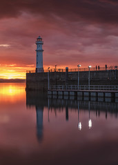 Newhaven sunset (raymond_carruthers) Tags: lighthouse sunset scotland edinburgh evening pier scottish sunsetcolours newhaven seascape firthofforth longexposure harbour eastcoast