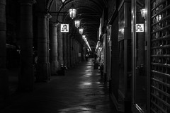 Nocturne / reflect and repeat (Özgür Gürgey) Tags: 2018 bw chopin colonnaden d750 darkcity hamburg nikon nocturne architecture evening grainy lowlight people reflection repetition street