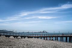 Down the beach (Melissa Maples) Tags: batumi batum ბათუმი adjara აჭარა georgia gürcistan sakartvelo საქართველო asia 土耳其 apple iphone iphonex cameraphone spring მწვანეკეპი mtsvanecape blacksea sea water beach blue pier skyline