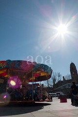H509_7925-2 (bandashing) Tags: hyde tameside civicsquare market childrens roundabout gordon cooke sunshine starburst ride sun bluesky light shaft colourful sylhet manchester england bangladesh bandashing aoa socialdocumentary akhtarowaisahmed