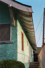 Roofline (ADMurr) Tags: la leica summicron kodak 200 spearmint stucco house m6 50mm rafter fence pole wire