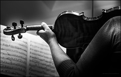 Practice time (Explored) (G. Postlethwaite esq.) Tags: bw dof beyondbokeh blackandwhite bokeh depthoffield monochrome musicalinstrument photoborder selectivefocus violin violinist