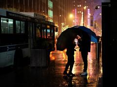 Radio City (Something Sighted) Tags: streetphotography rain reflections night scènederue newyorkcity nyc umbrella parapluie busstop