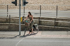 Cyclists crossing (PhredKH) Tags: bicycles canoneos7dmkii canonphotography coastalbritain coastaltown ef70200mmf28lisiiusm fredkh onthestreet peopleonthestreet photosbyphredkh phredkh splendid streetphotography worthing bikes fence pedestriancrossing pedestrians people peoplewatching road street 70200mm bike