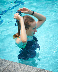 Skyline Waterpark Day 220 (C & R Driver-Burgess) Tags: swimming crawl overarm breaststroke goggles onepiece togs swimsuit bathers reach girl boy face arms hand teen young preteen purple black green length lap class relax breath clear blue water long blonde golden hair pale dark skin complexion floats buoys divider umbella sign exertion sport