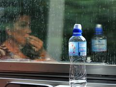 Ritratto di donna (maurizio.s.) Tags: bottle woman donna portrait ritratto reflexion nikon travel treno train nikond700 nikon80200